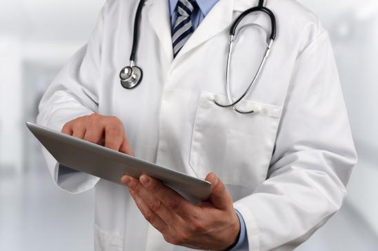 doctor using digital tablet xs