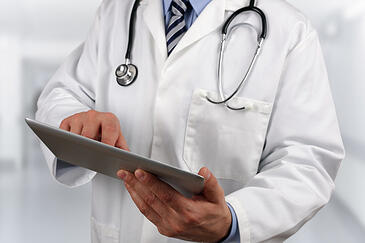 doctor using digital tablet xs